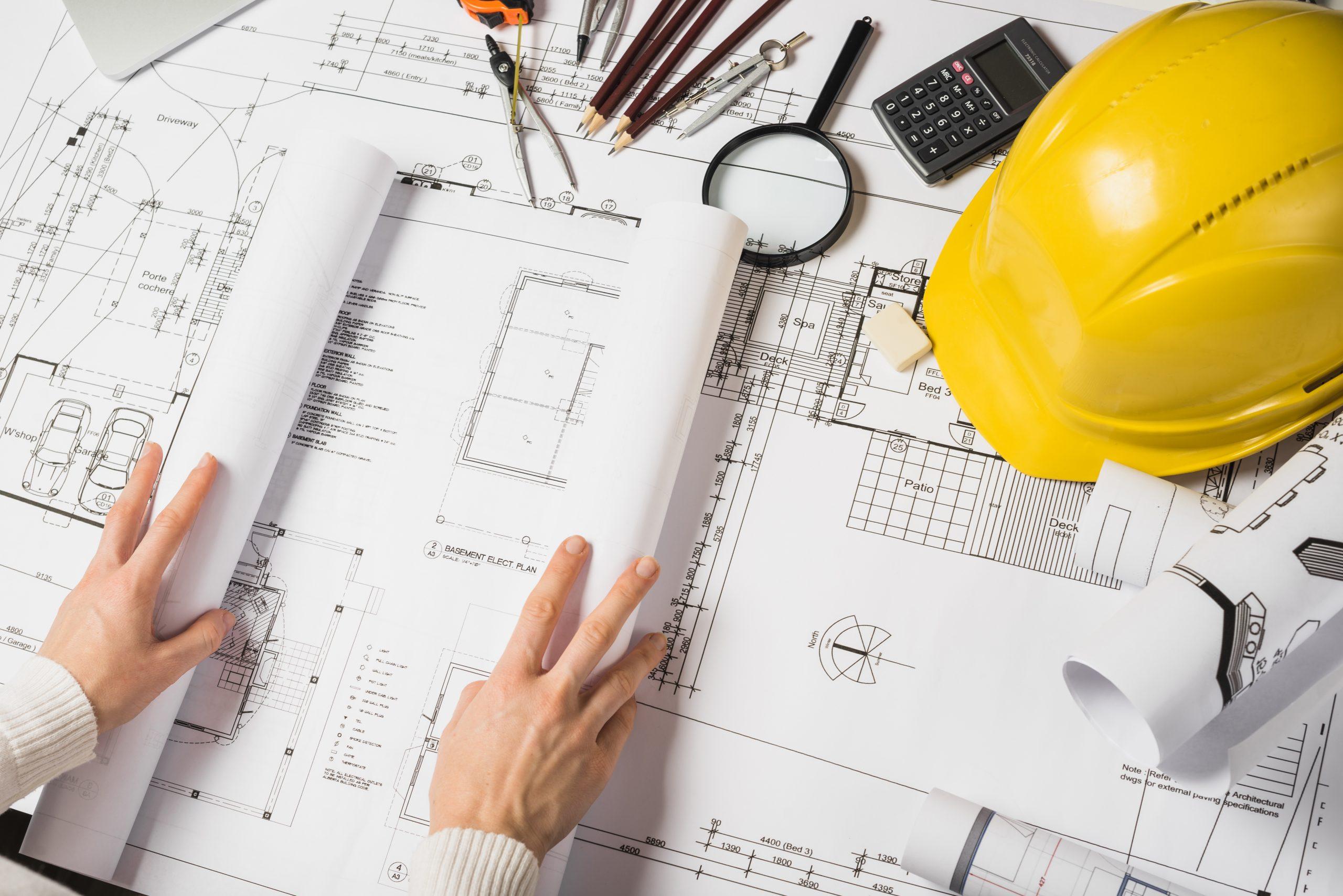 crop-architect-opening-blueprint