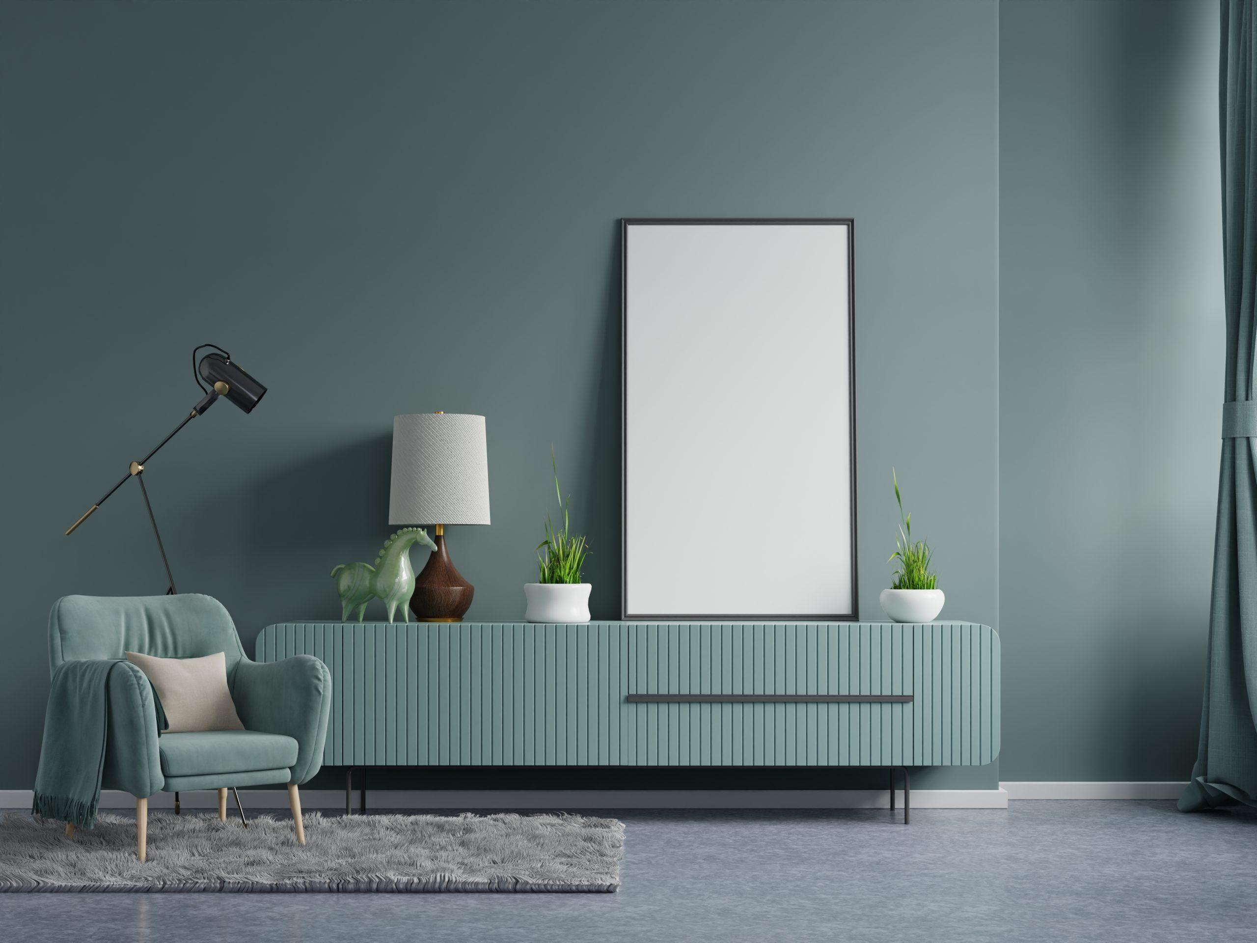 Poster mockup with vertical frames on empty dark green wall in living room interior with dark green velvet armchair.3D rendering