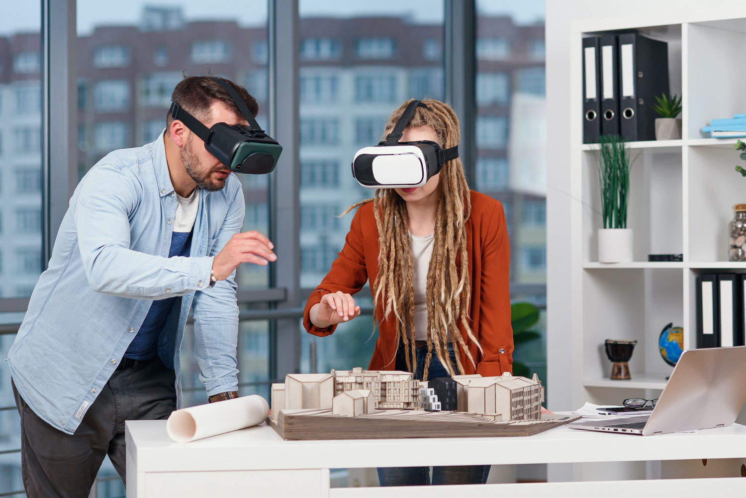professional-architect-working-office-desk-wearing-vr-headset-he-is-viewing-virtual-reality-interface