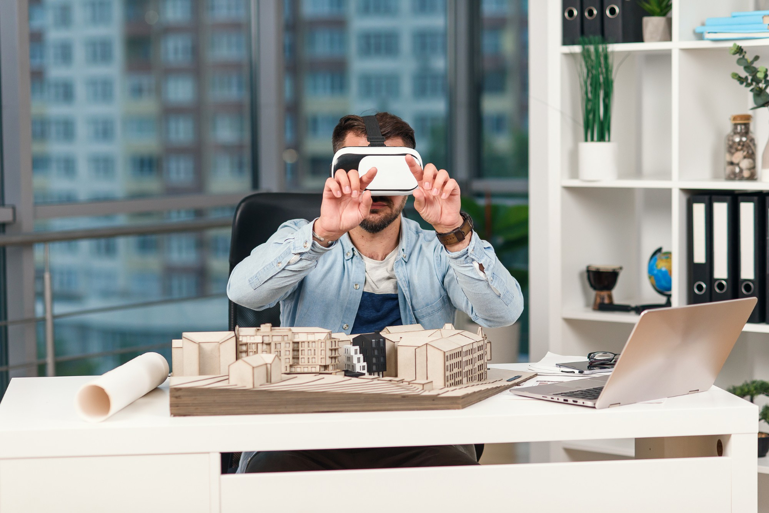 skilled-male-architect-reviewing-architectural-project-with-augmented-reality-glasses-design-bureau